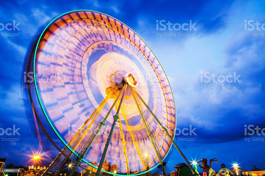 Ferris wheel at an amusement park stock photo