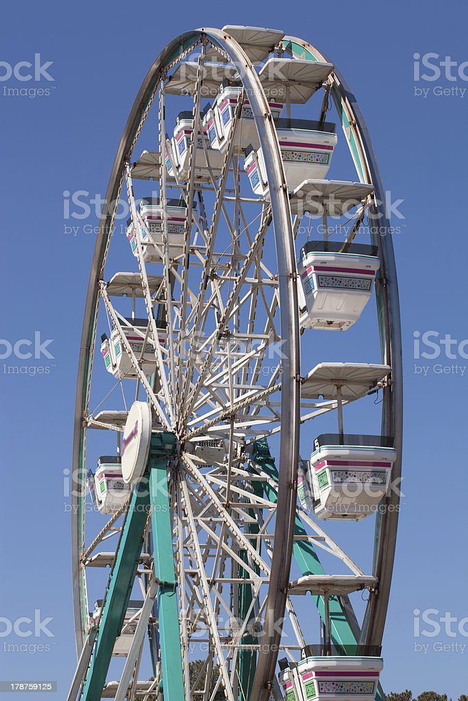 Ferris Wheel at the Local Fair Against a Blue Sky stock photo