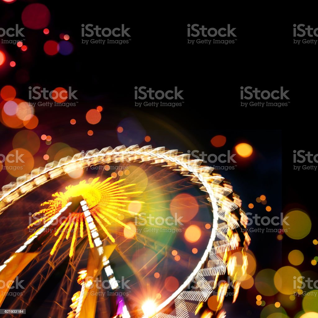 Ferris wheel background with bokeh effects stock photo