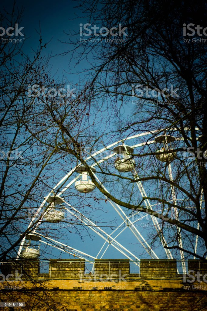 Ferris wheel behind trees in lincoln stock photo
