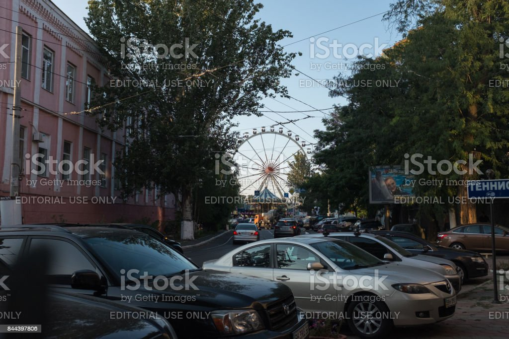 Ferris wheel between the roads in the city center stock photo