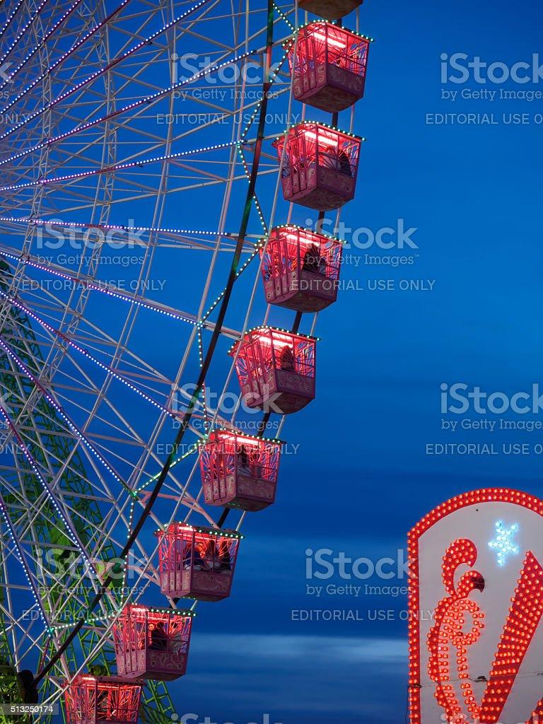Ferris wheel illuminated at night in april fair of Seville. stock photo