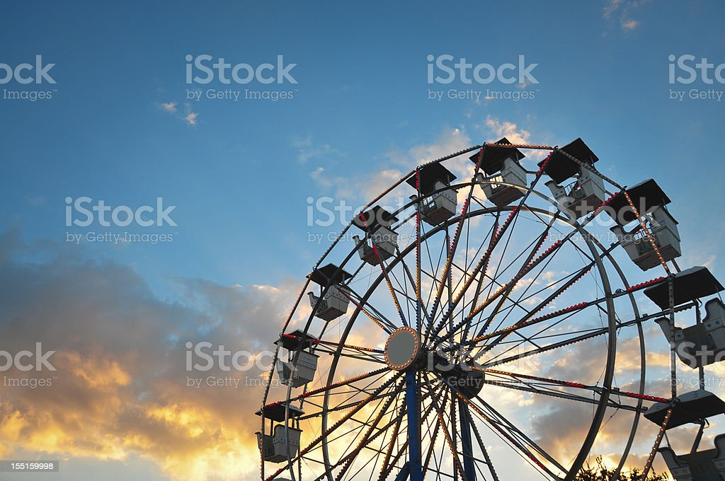 Ferris Wheel in beautiful sunset light stock photo