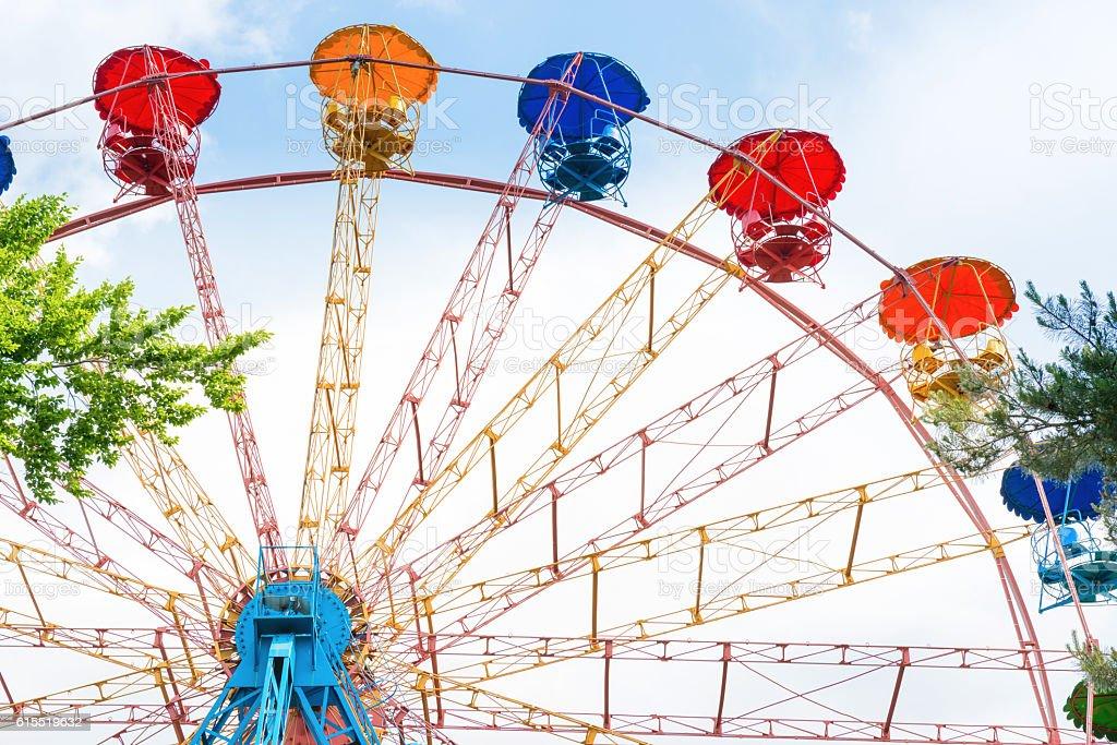 Ferris wheel in the green park stock photo