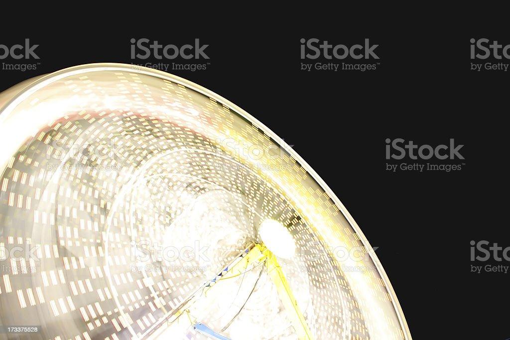 Ferris wheel motion blur at night royalty-free stock photo
