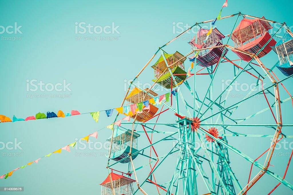 Ferris wheel on blue sky background vintage color stock photo