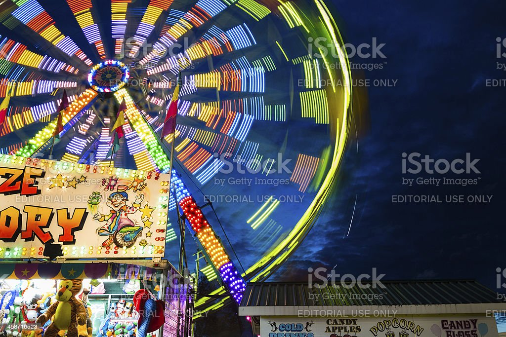 ferris wheel on fairgrounds-in motion stock photo