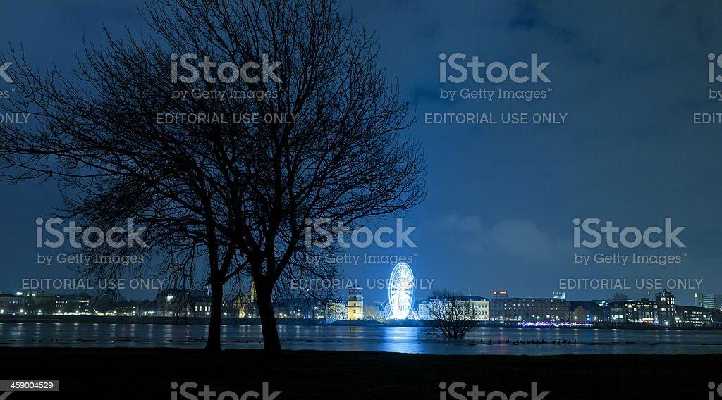 ferris wheel on Rhine Promenade in Dusseldorf at night stock photo