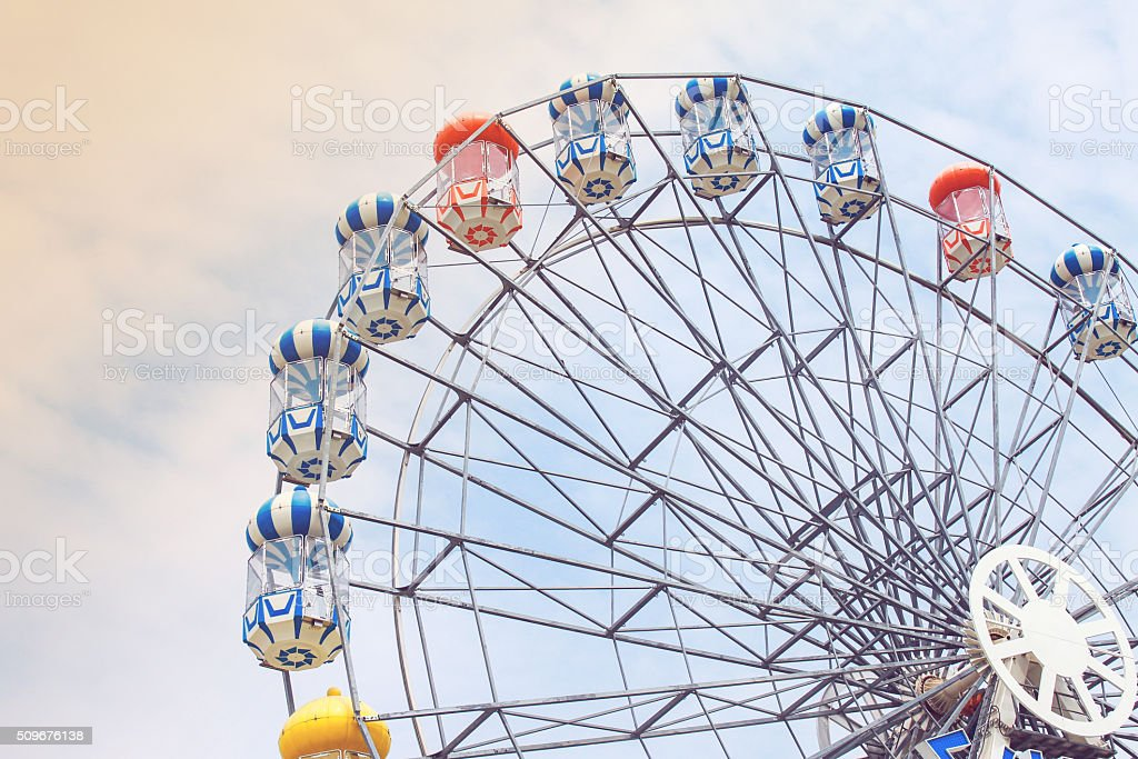 Ferris wheel on sky and cloud background stock photo