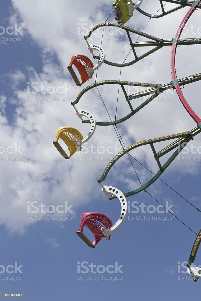 Ferris Wheel Spinning Against a Clear Blue Sky stock photo