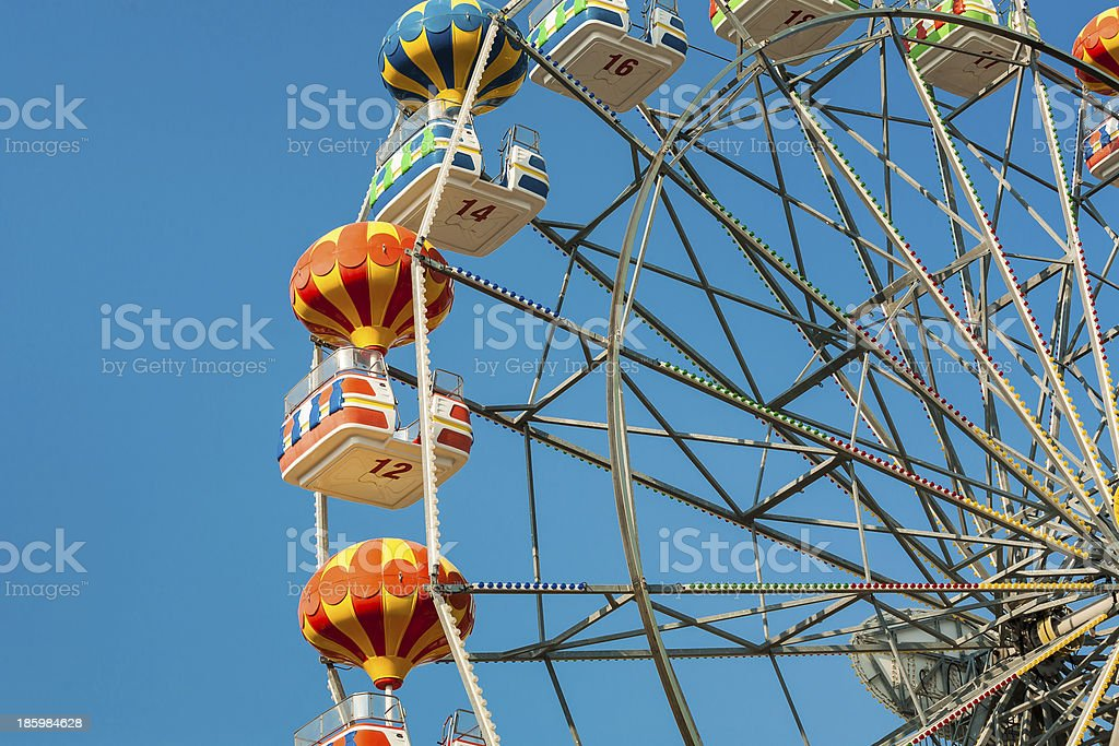 Ferris wheel with carriages in different colors. royalty-free stock photo