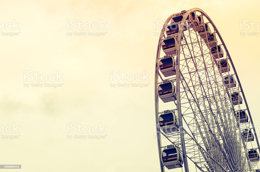 Ferris wheel with sky process in retro styled stock photo