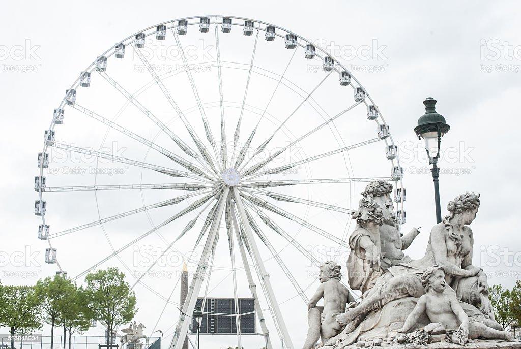 Ferris Wheel With Statue stock photo