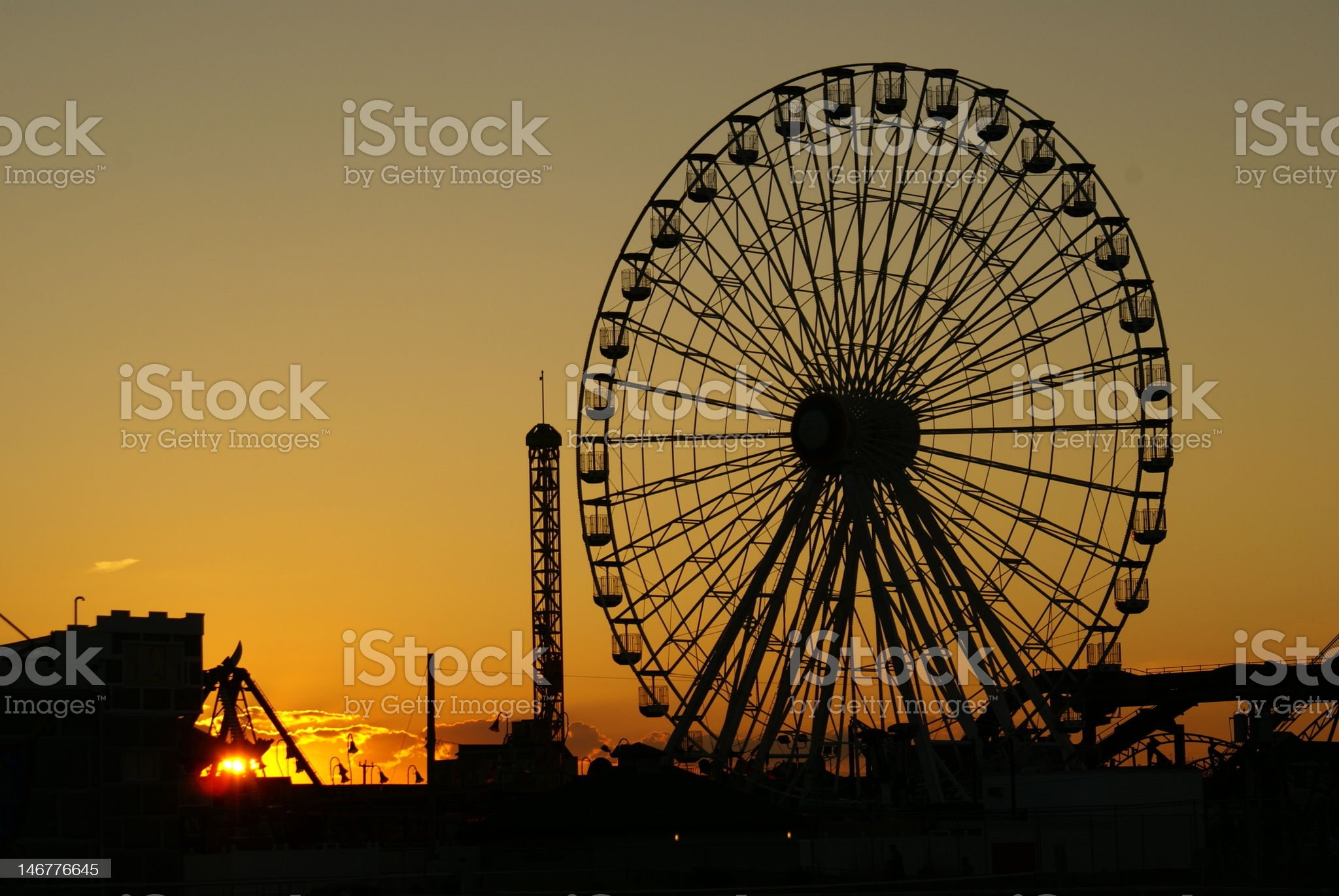 Ferris Wheel with sunset in background royalty-free stock photo