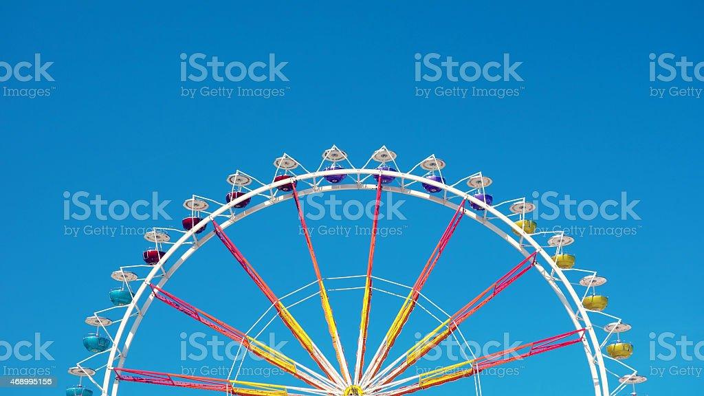 Ferris Wheel with wonderful blue sky stock photo
