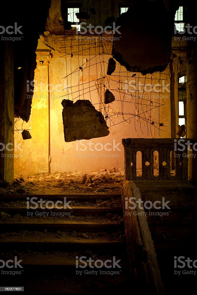 Ferroconcrete stones hanging in abandoned building royalty-free stock photo