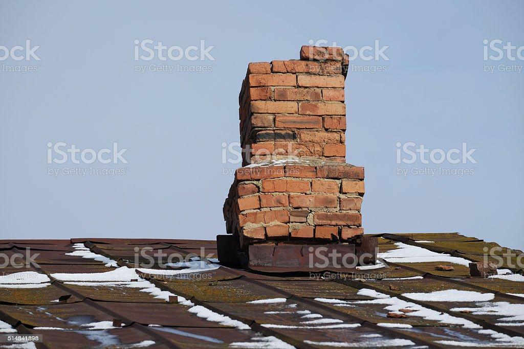 Ferruginous roof and old flue stock photo