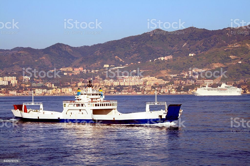 Ferry and Cruise ship on strait of Messina Sicily Italy stock photo