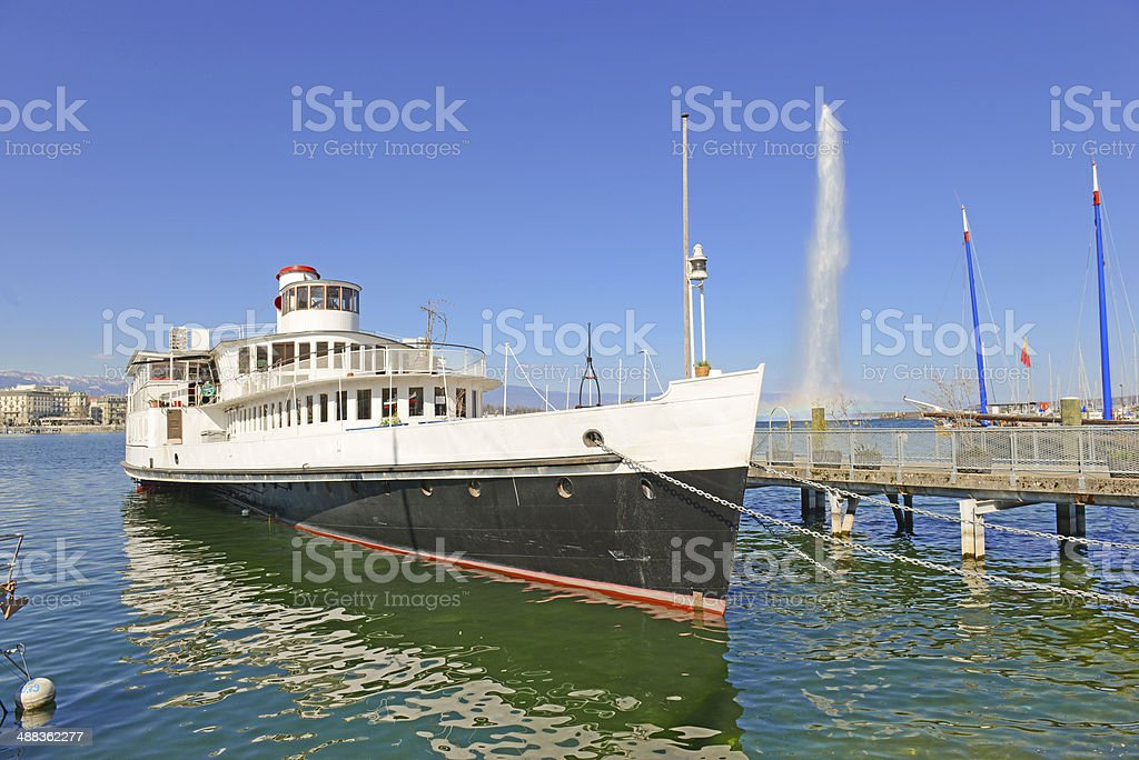 Ferry and Jet d'Eau Fountain in Lake Geneva, Switzerland royalty-free stock photo