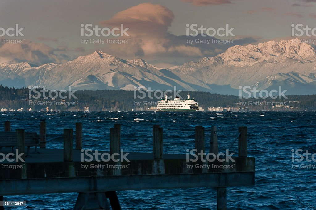 Ferry and Olympic Mountains stock photo
