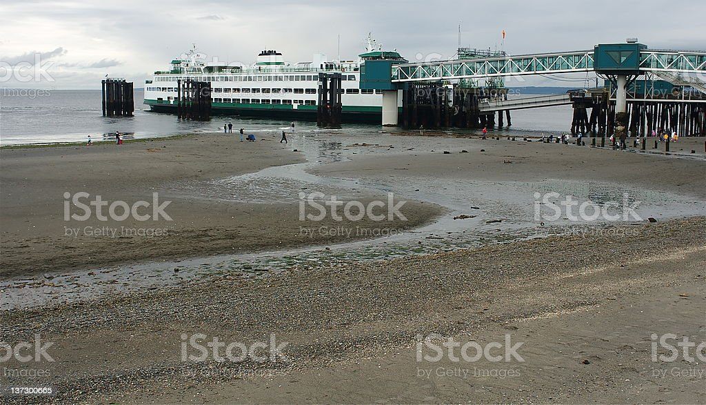 Ferry and People at Low Tide stock photo