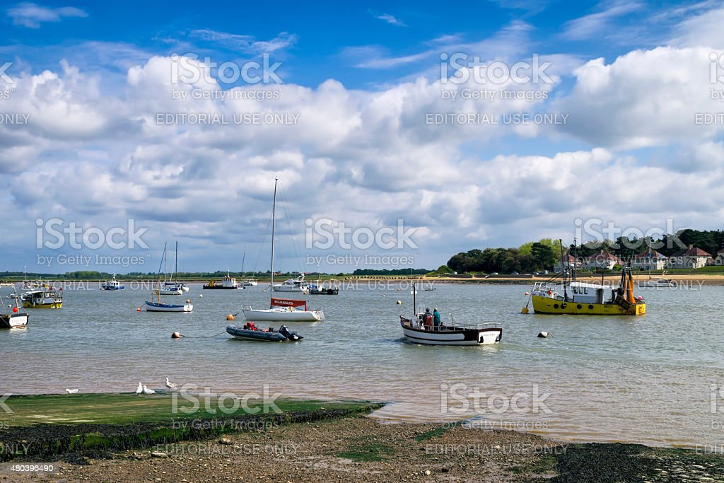 Ferry and small boats at Felixstowe Ferry stock photo