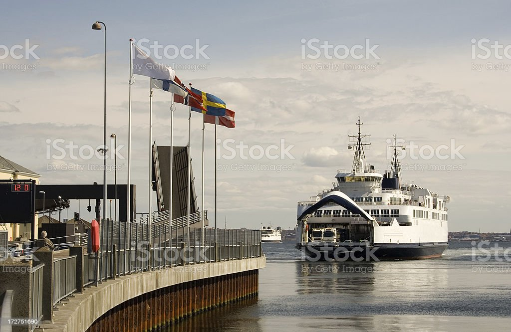 Ferry arrives at harbour stock photo