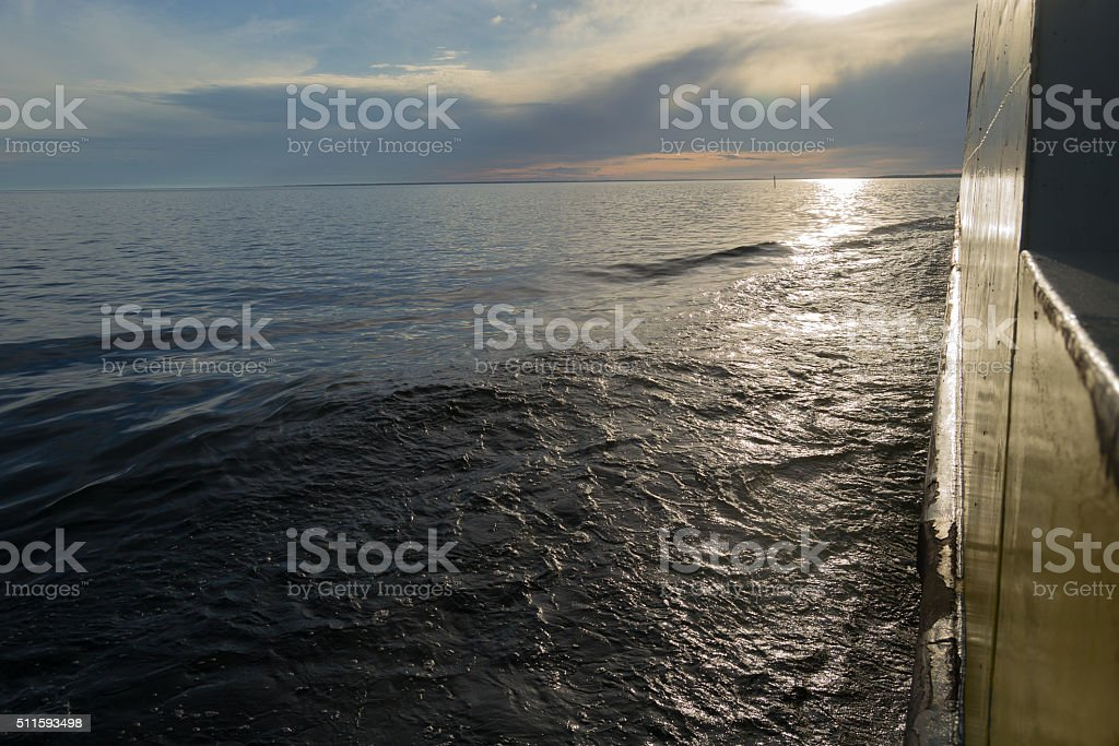 Ferry at sea at sunset in Northern Finland stock photo