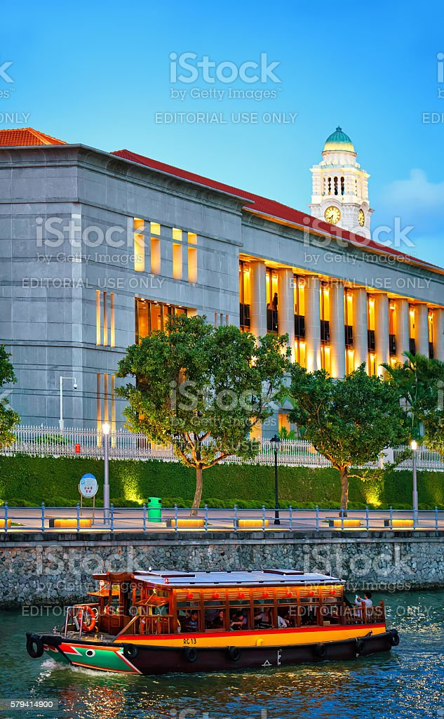 Ferry boat and Parliament building at Boat Quay in Singapore stock photo