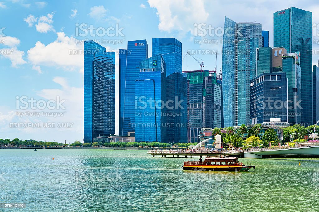 Ferry boat and Skyline in Downtown Core at Marina Bay stock photo
