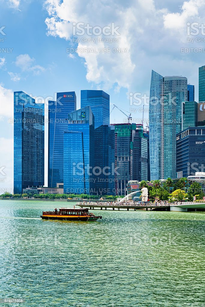 Ferry boat and Skyline of Downtown Core at Marina Bay stock photo