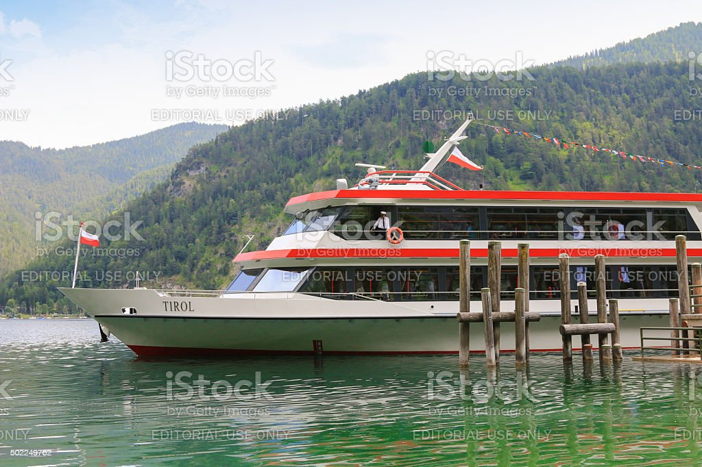 Ferry boat cruising along the Achensee Lake in Austria stock photo