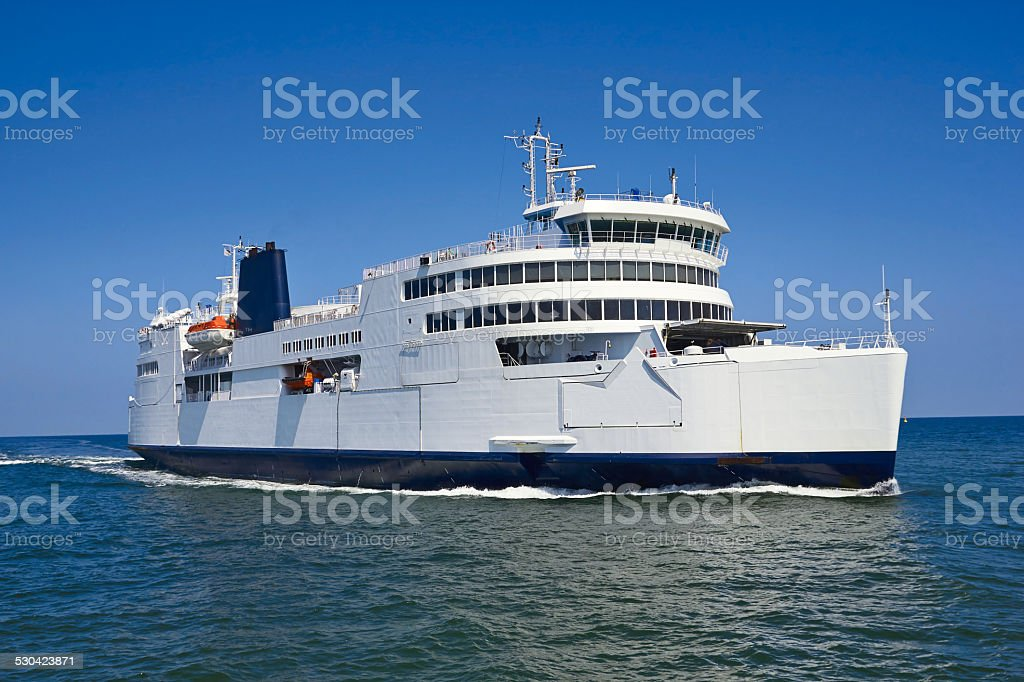ferry boat in open waters stock photo