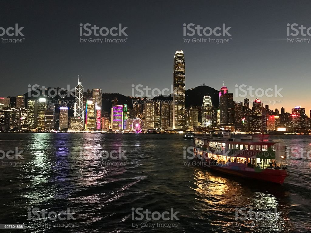 Ferry crossing Victoria Harbour at sunset stock photo