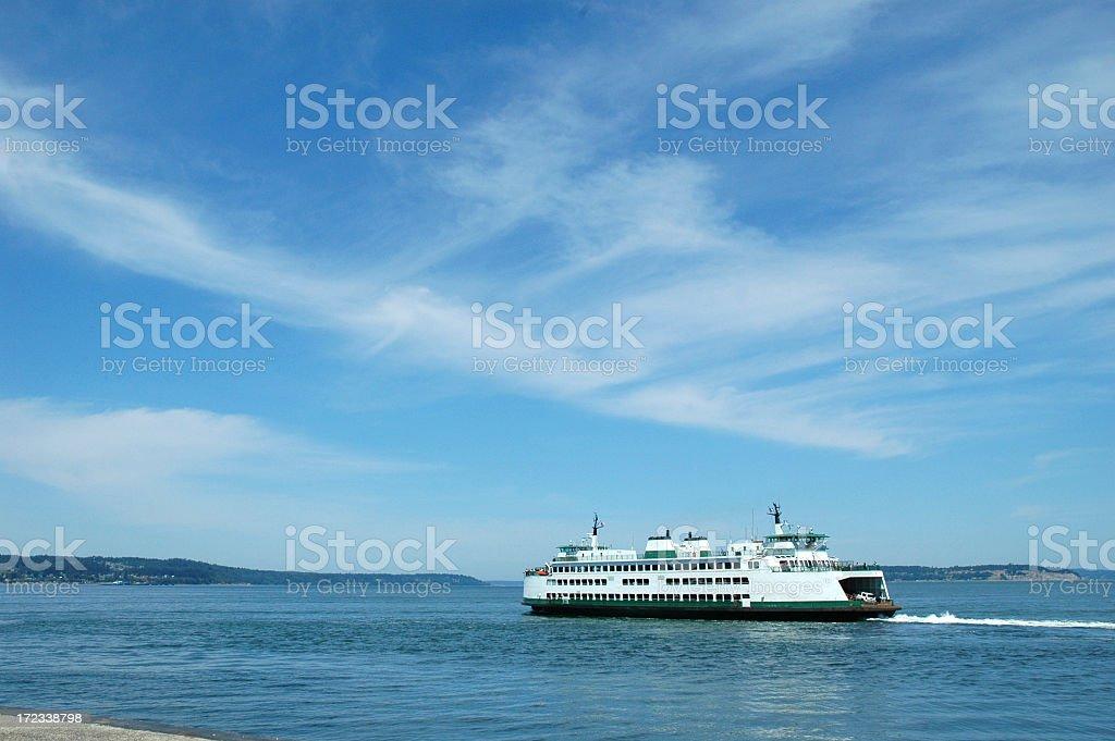 Ferry cruising on ocean under blue sky royalty-free stock photo