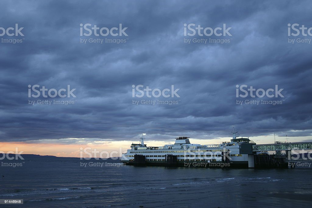 Ferry departing under stormy sky royalty-free stock photo