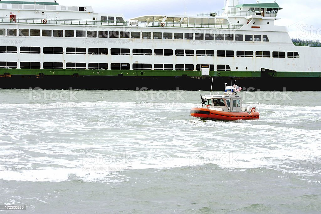Ferry escorted  by gunship, homeland security royalty-free stock photo
