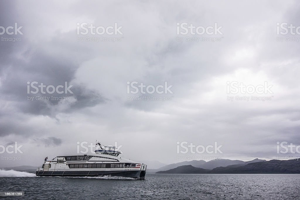 Ferry in a fjord stock photo