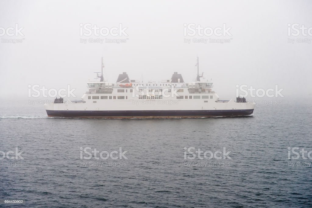 Ferry in a fog stock photo