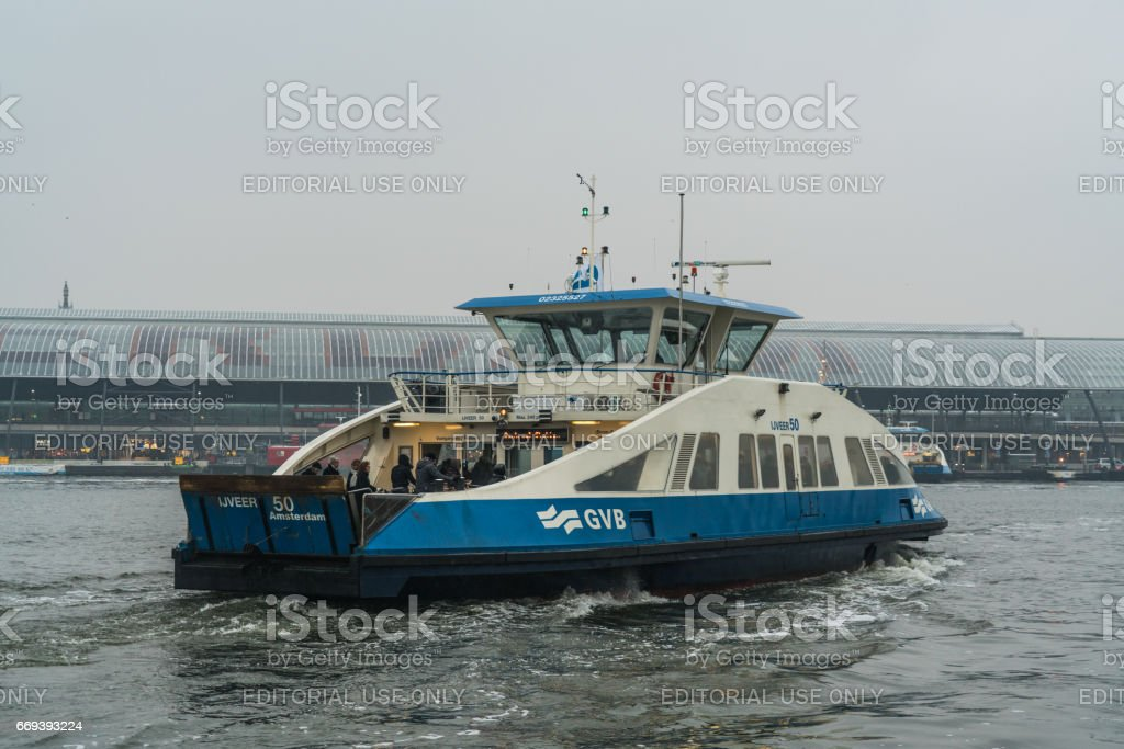 Ferry in Amsterdam stock photo