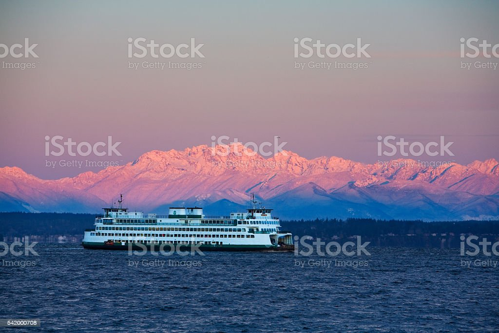 Ferry in front of Olympic Mtns stock photo