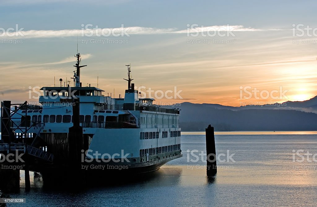 Ferry in sunrise stock photo
