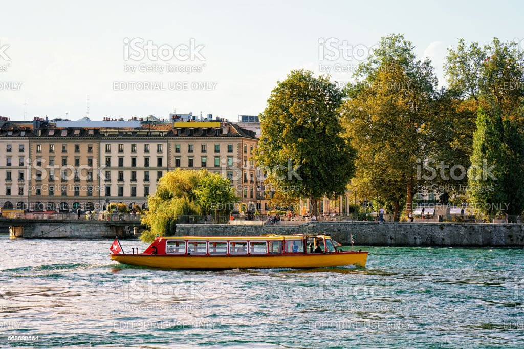 Ferry on Geneva Lake near embankment of Promenade du Lac stock photo
