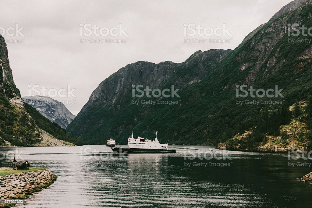 Ferry on the fjord stock photo