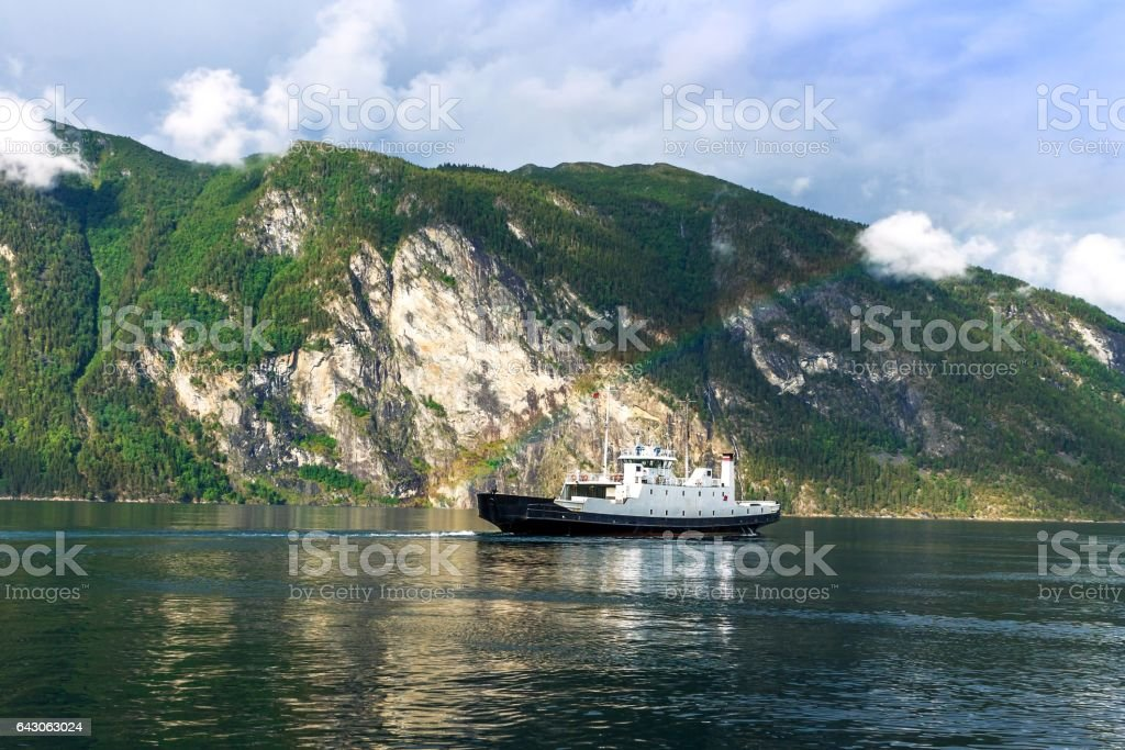 Ferry on the fjord with a rainbow, Norway stock photo
