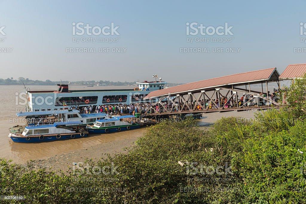 Ferry passengers disembark in Yangon, Myanmar stock photo