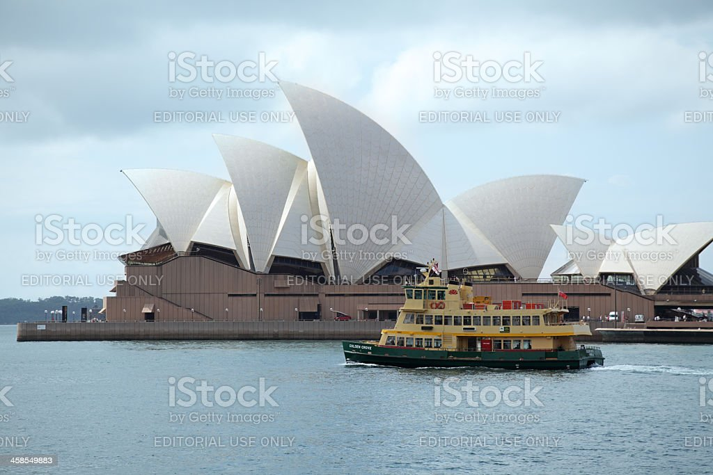 Ferry sailing in front of the Sydney Opera House royalty-free stock photo