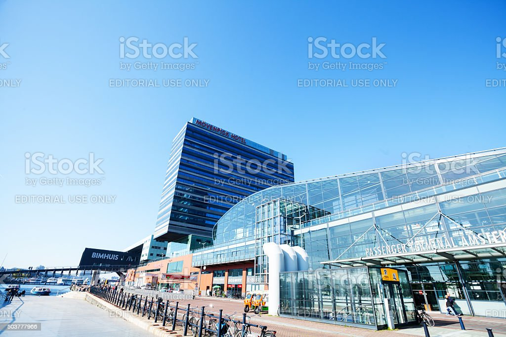 Ferry terminal and Mövenick Hotel in Amsterdam stock photo