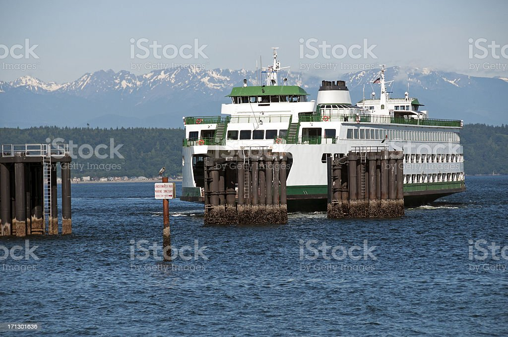 Ferryboat arriving at dock on Puget Sound stock photo
