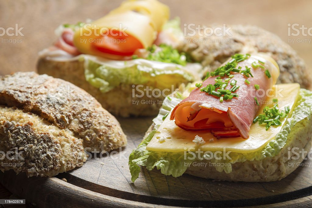 Fesh sandwich with lettuce, cheese, ham and chive royalty-free stock photo